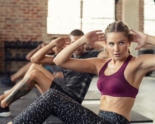 woman-doing-abs-exercise-at-cardio-course-PLQKSM2-min.jpg